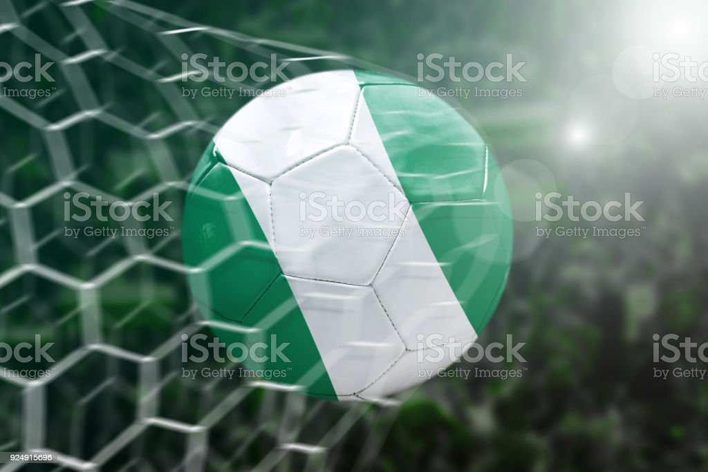 Scoring a Goal, Nigerian soccer ball stock photo