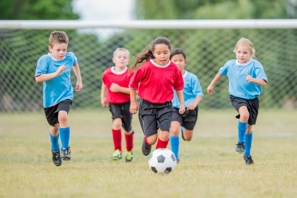 scoring a goal - soccer competition stock photos and pictures