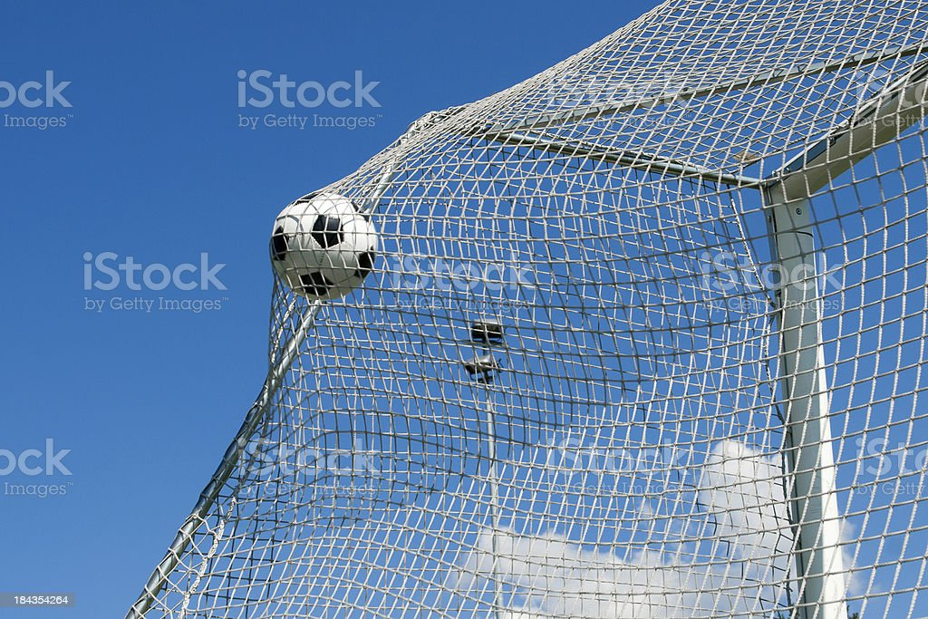 Scoring great soccer goal with a football royalty-free stock photo