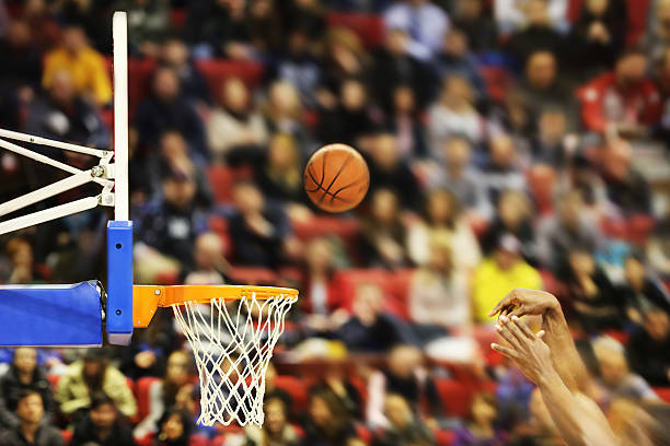 Scoring the winning points at a basketball game Scoring the winning points at a basketball game , motion blur leisure games stock pictures, royalty-free photos & images