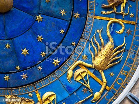 904302038 istock photo Scorpio astrological sign on ancient clock. Detail of Zodiac wheel with scorpion. 1180618738