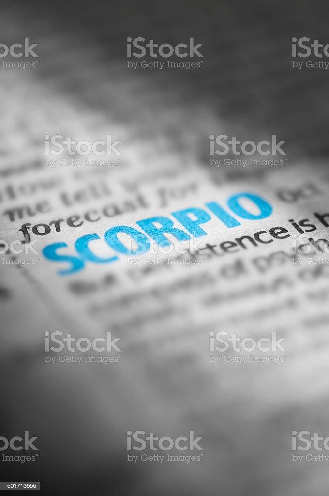 Scorpio horoscope in a newspaper typed in blue stock photo