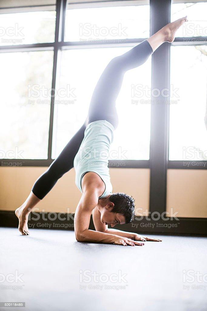 Scorpion Pose Yoga woman stock photo