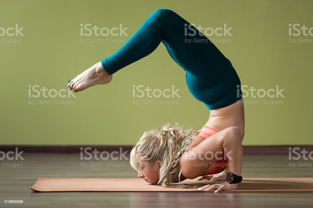 Scorpion yoga Pose stock photo