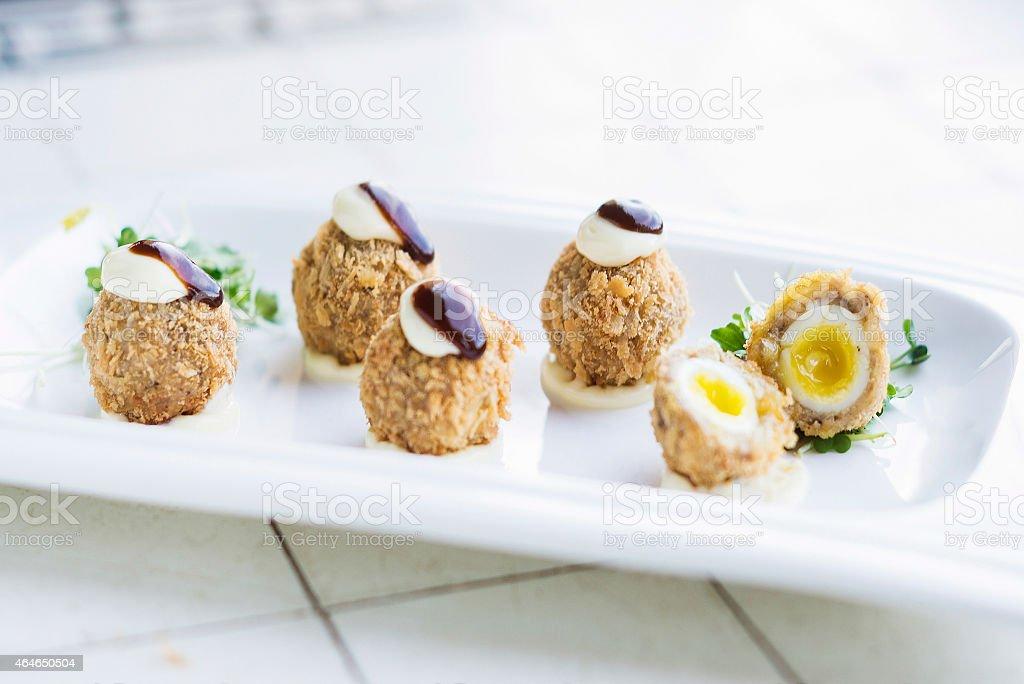scotch breaded eggs  contemporary fusion style stock photo