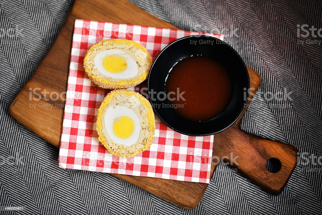 Scotch egg in meat and breaded with hot chili sauce stock photo