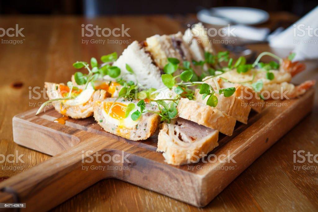 Scotch egg on platter stock photo