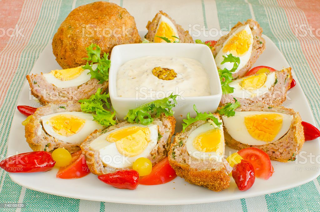 Scotch Eggs with mustard dip royalty-free stock photo