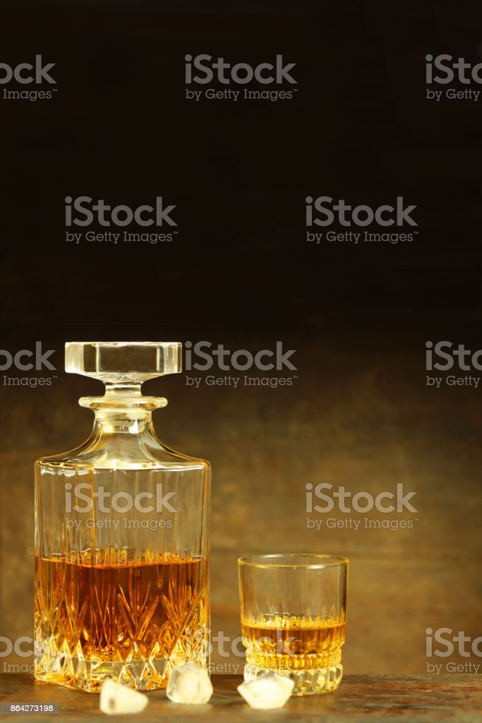 Scotch Whiskey Decanter and Crystal Glass on Rustic Background royalty-free stock photo