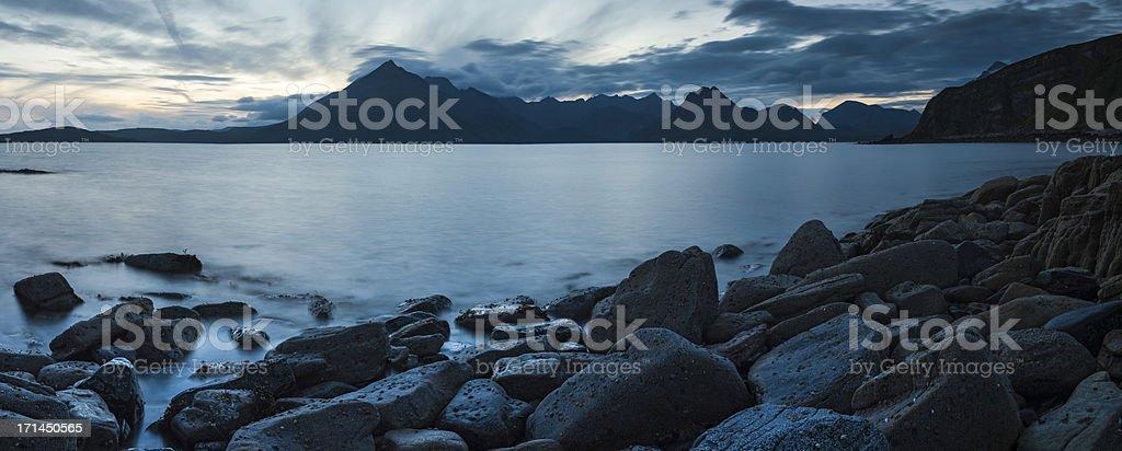 Scotland blue sunset over Cuillin mountains Skye panorama stock photo