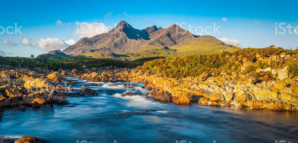Scotland Cuillin peaks rising over mountain stream Highlands panorama Skye stock photo