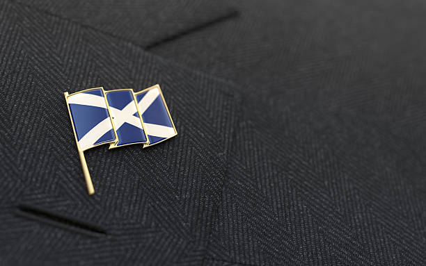 scotland flag lapel pin on the collar of a suit - jacket stock photos and pictures