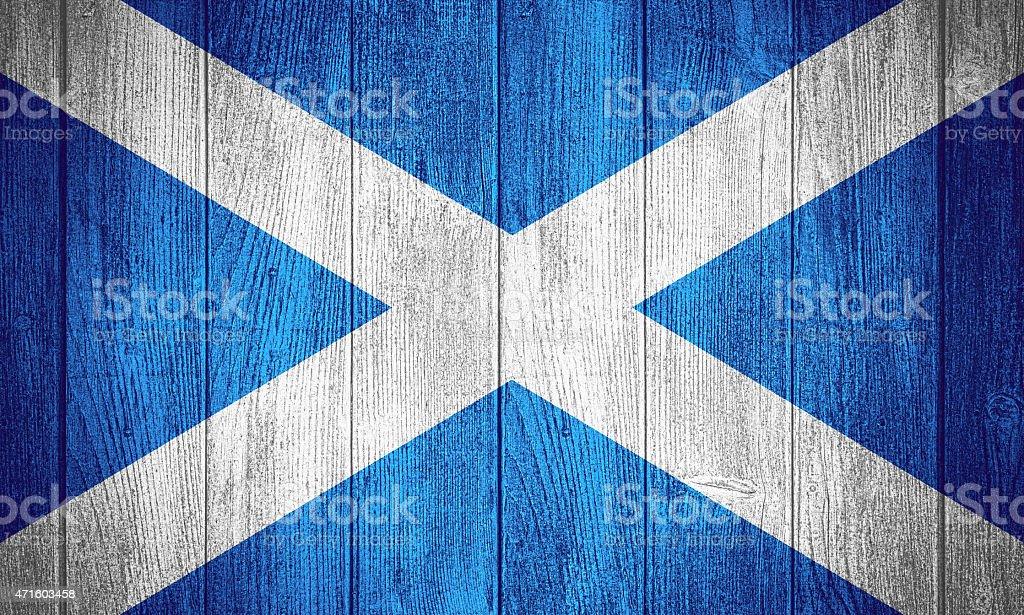 Scotland flag or Scottish banner on wooden boards background