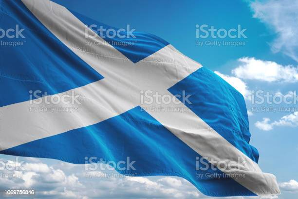 Scotland flag waving cloudy sky background picture id1069756846?b=1&k=6&m=1069756846&s=612x612&h=a hsjbwsiwati53iodtu85mecksyz1ub9g15sbora2w=