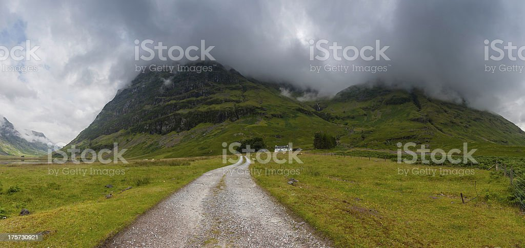 Scotland Glen Coe dramatic cloudscape brooding mountains remote Highlands croft stock photo