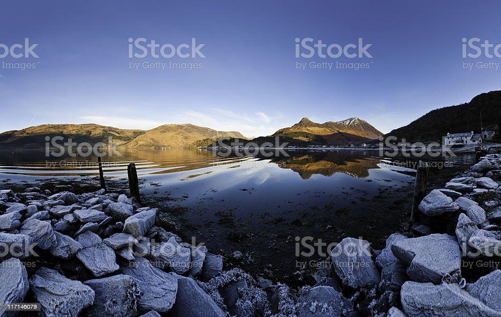 Scotland Glencoe village Pap of Glen Coe reflecting Highland loch stock photo
