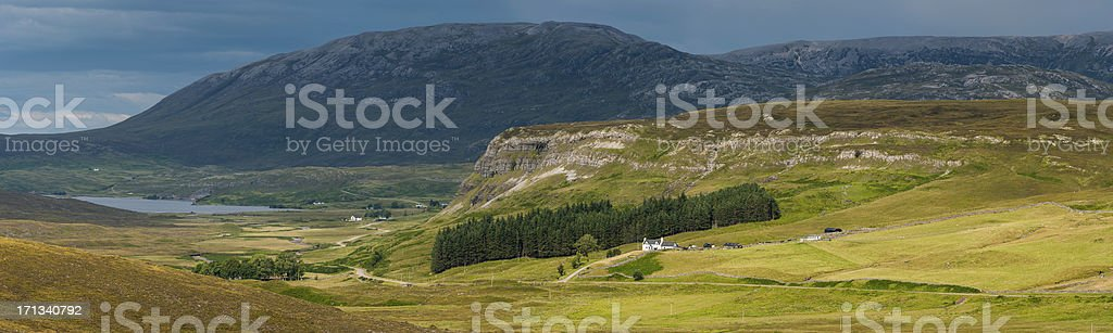 Scotland Highland mountain glen crofters cottages and loch panorama royalty-free stock photo