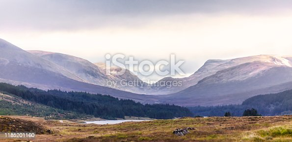 Amazing view over Scotlands Highlands mountains and valleys with dramatic heavy clouds