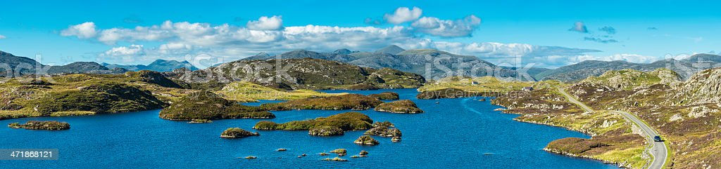 Scotland idyllic heather islands remote mountain loch Western Isles panorama stock photo