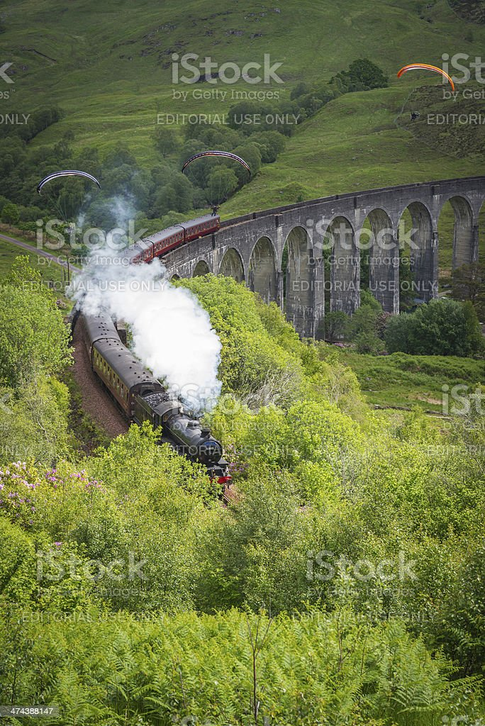 Scotland Jacobite steam train and paragliders over Glenfinnan viaduct Highlands stock photo