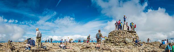 Scotland mountain hikers on summit of Ben Nevis Highlands panorama stock photo