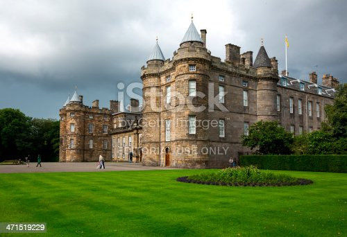 Edinburgh, United Kingdom - July 28, 2012: Visitor swalking in the forecourt in front of the main entrance of the Holyroodhouse Palace