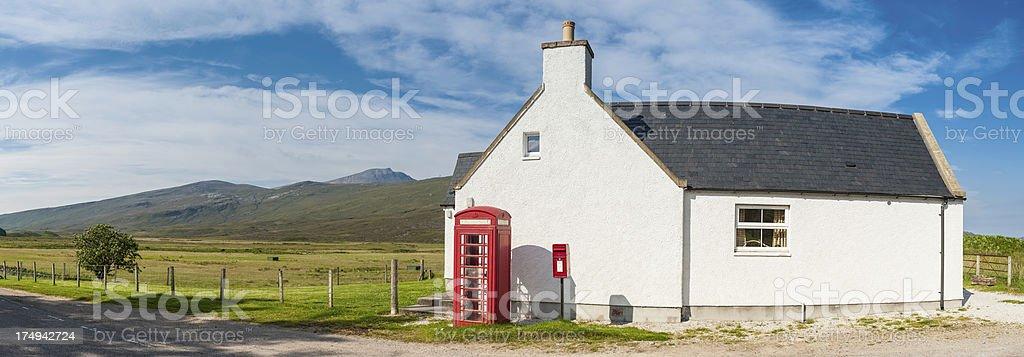 Scotland red telephone box beside Highland croft stock photo