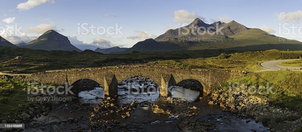 Scotland sunrise on ancient bridge Cuillin mountains Skye stock photo