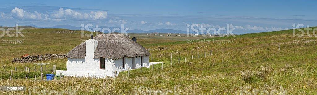 Scotland traditional thatched croft cottage Highlands landscape stock photo