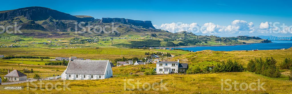 Scotland whitewashed crofts idyllic rural village Highlands mountain shore panorama stock photo