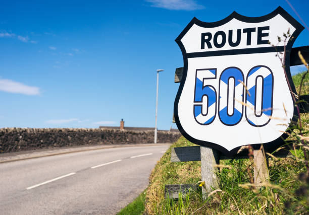 Scotland's North Coast 500 route A sign near Thurso on Scotland's North Coast 500 route, a well known scenic drive around the coastline of the far north of Scotland. north coast 500 stock pictures, royalty-free photos & images