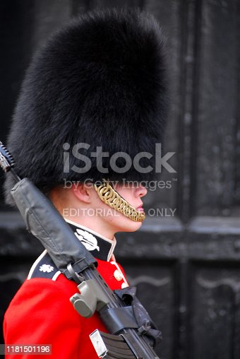 London, England: guard standing with rifle on shoulder outside St James palace - sentry of the Scots Guards, part of the Royal Guard