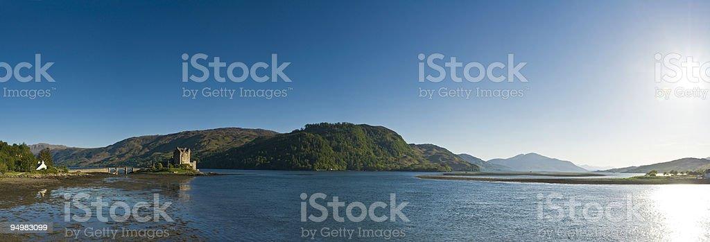 Scottish castle loch sunburst royalty-free stock photo