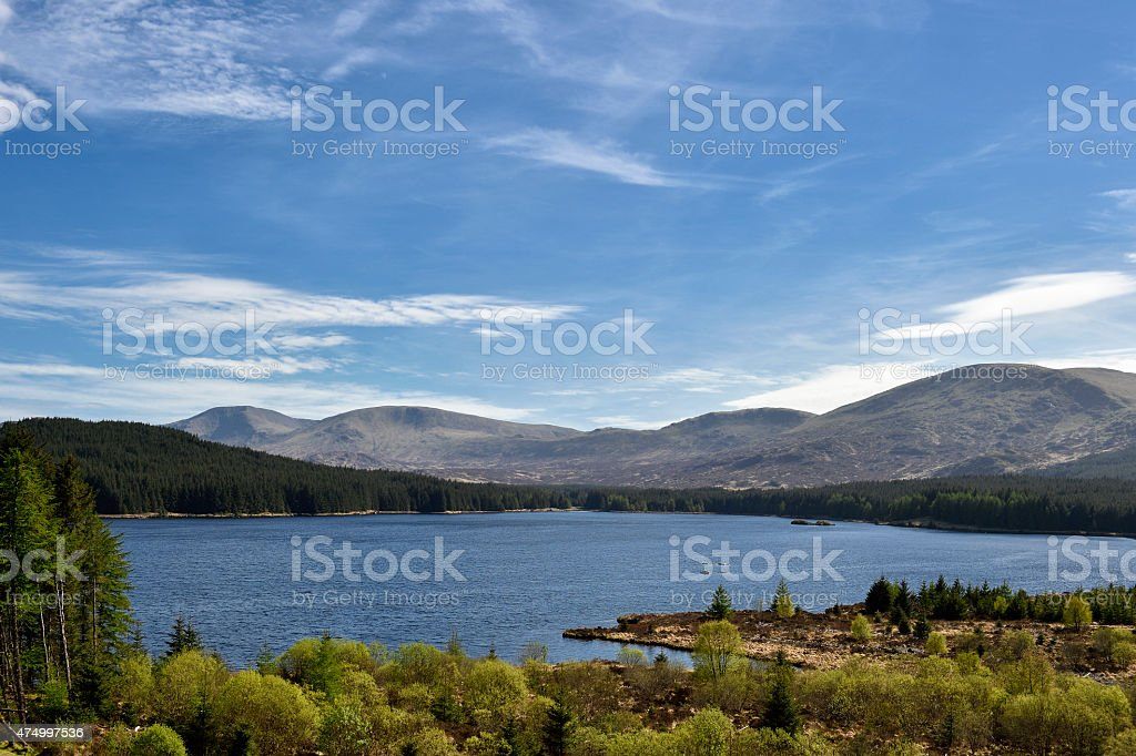 Scottish countryside with hills and Loch Riecawr stock photo
