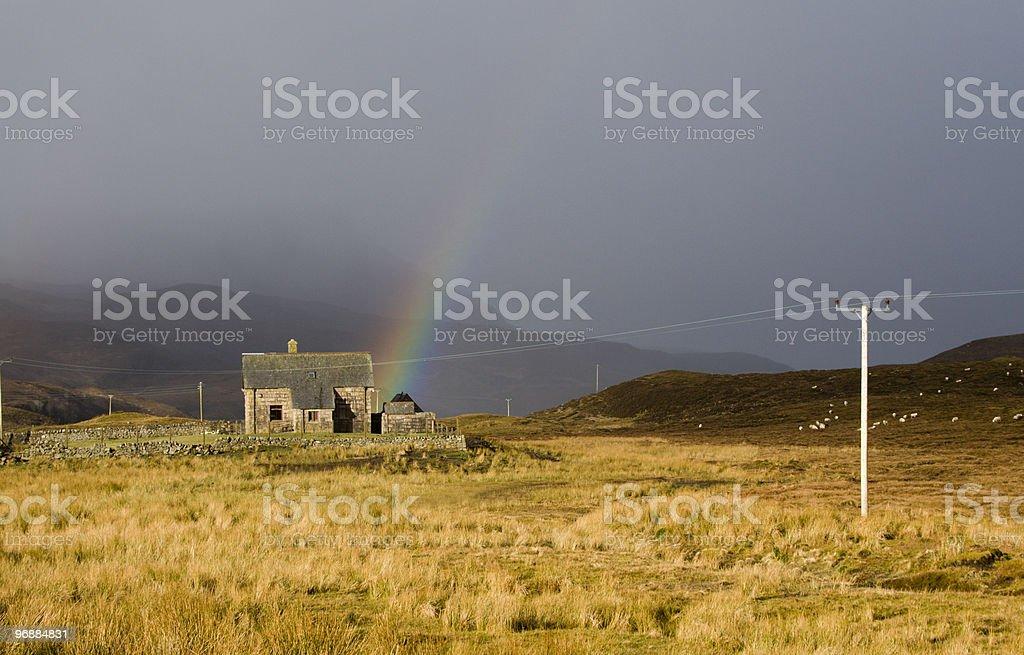 Scottish Croft with Storm and Rainbow stock photo