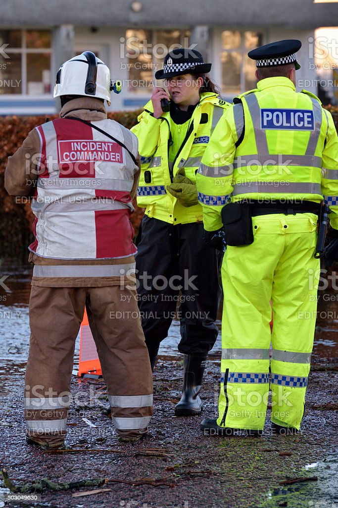 Scottish fire brigade personnel and police attending a flood stock photo