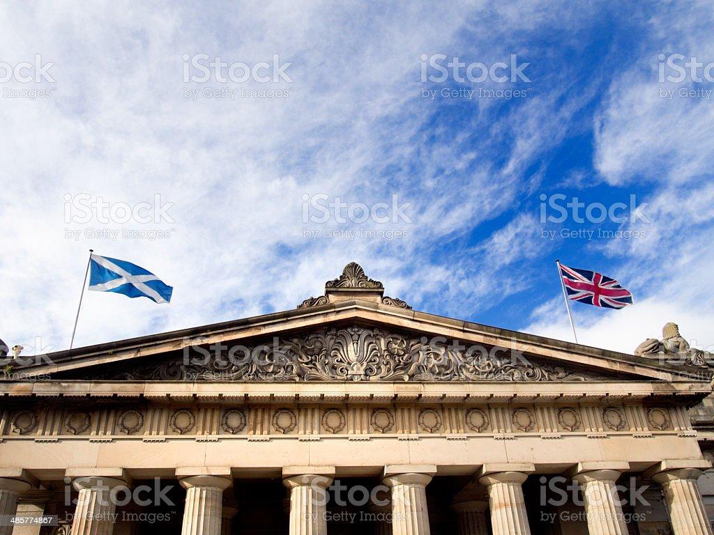 Scottish flag  and union jack in wind stock photo