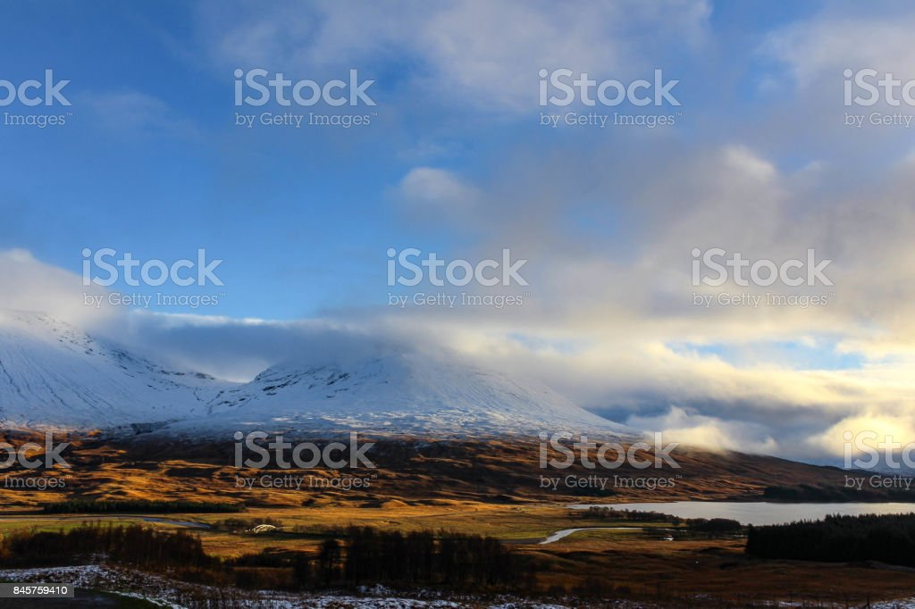 Scottish Highlands Snow Capped Mountains Landscape stock photo