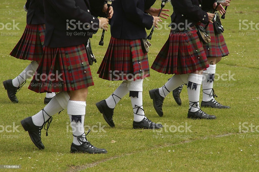 Scottish kilted pipers marching stock photo