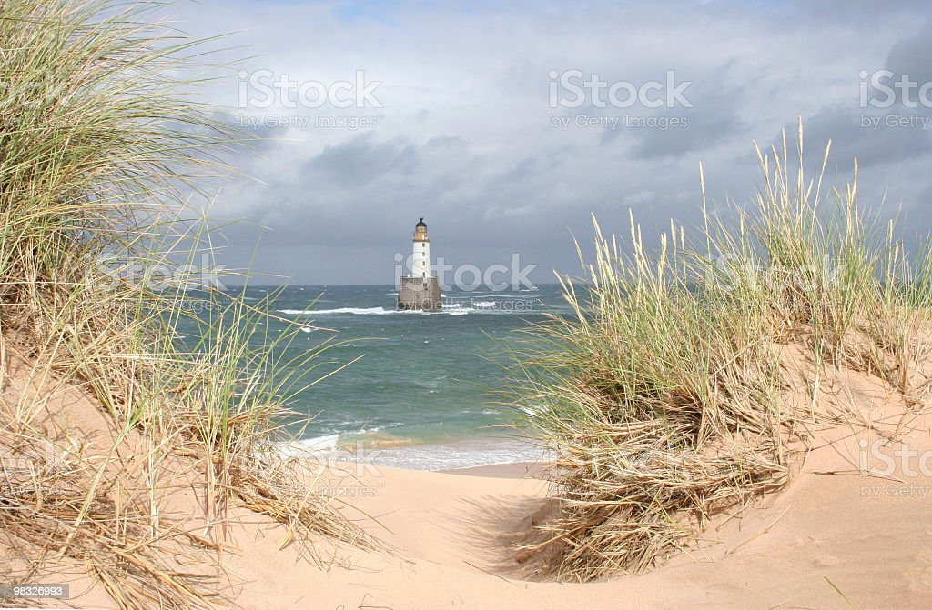 Scottish lightouse in sea on windy, stormy day royalty-free stock photo