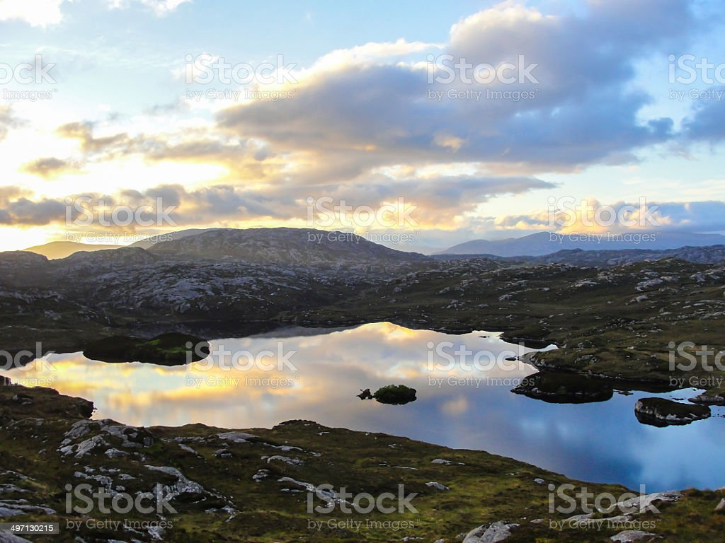 Scottish loch in the moorland at sunset stock photo