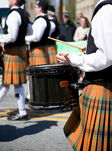 Detail on a  drum player part of a traditionnal scottish pipe marshing band. Shot on Saint Patrick's day parade in Atlanta Georgia..