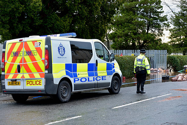 Scottish police officer at the scene of flooding stock photo
