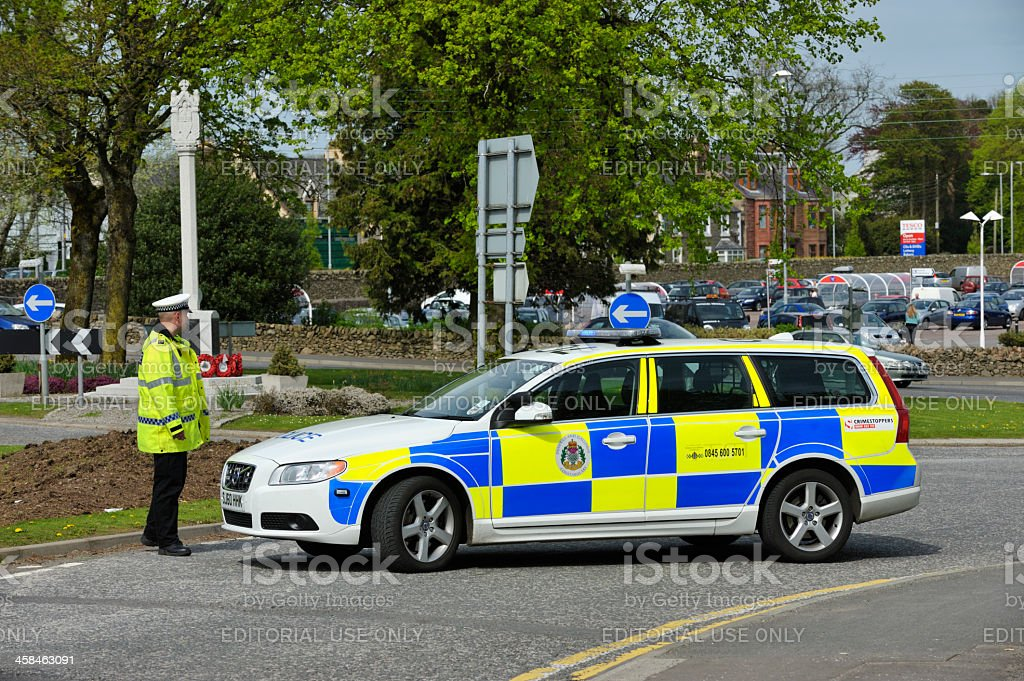 Scottish police officers and a parked police car royalty-free stock photo