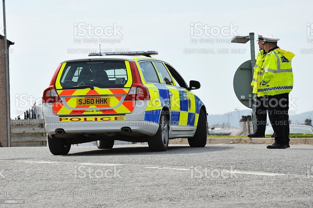 Scottish police officers and a parked police car stock photo