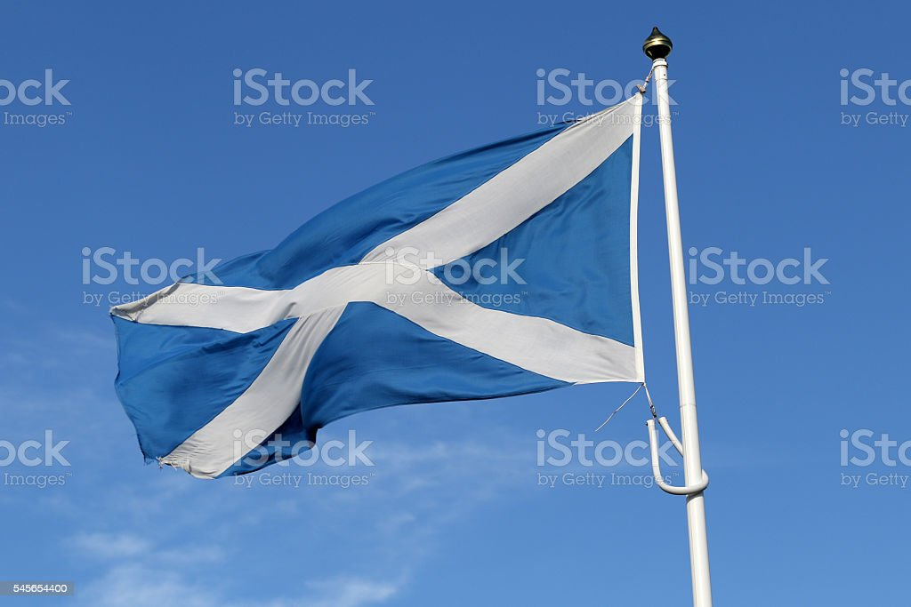 Scottish Saltire flag (St. Andrew's Cross) blowing in the wind stock photo