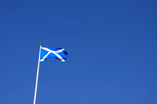 Scottish Saltire Flying Against An Azure Blue Sky. stock photo