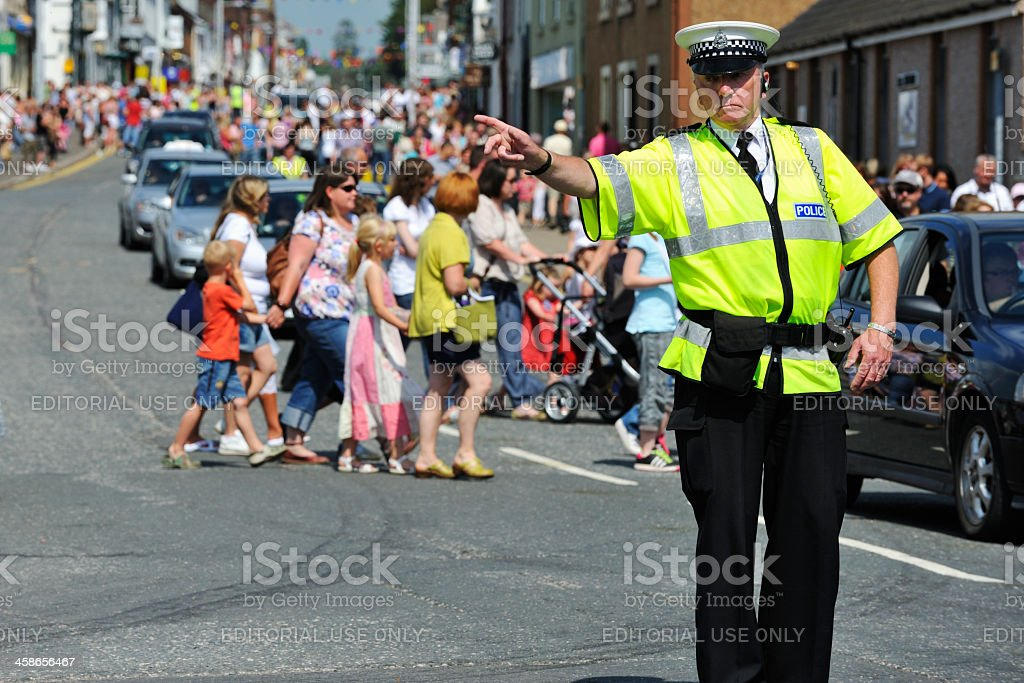 Scottish traffic police officer directing traffic stock photo