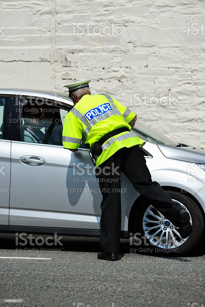 Scottish traffic police officer talking to a car driver stock photo