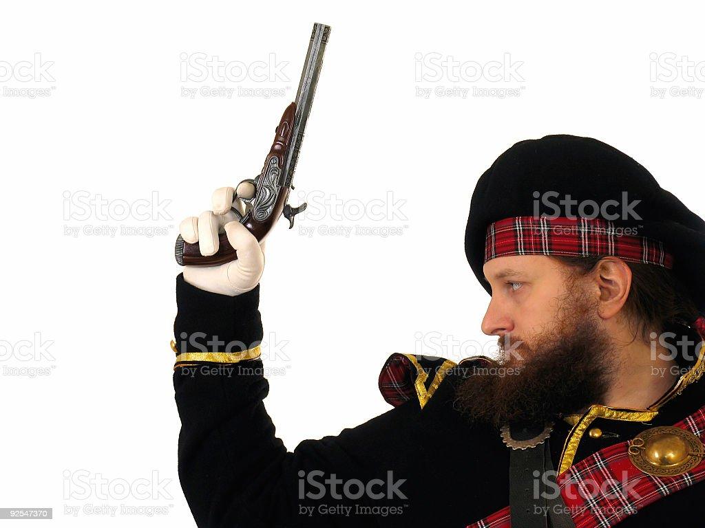 Scottish warrior with pistol royalty-free stock photo